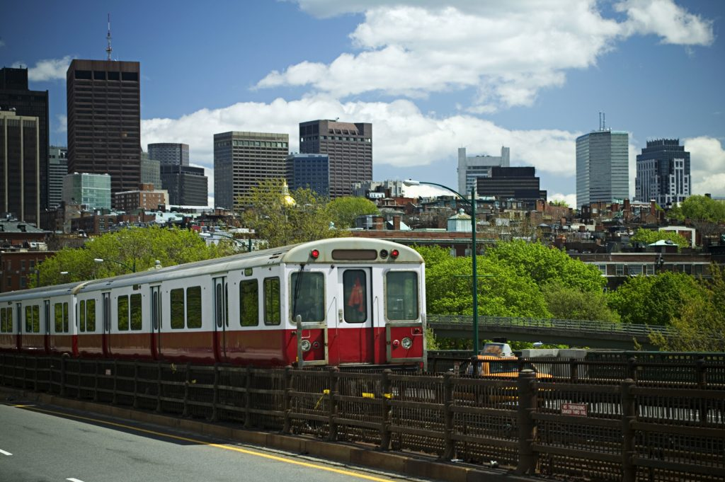 A train with Boston skyline background