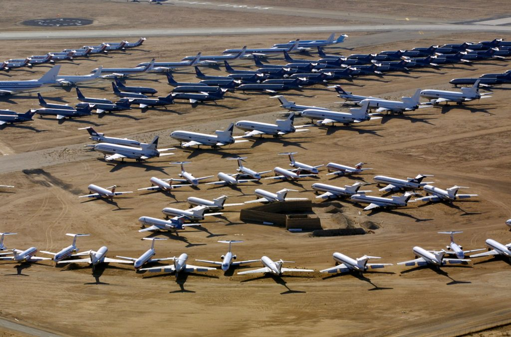 397766 09: Commercial airliners sit at the Southern California Logistics Airport November 26, 2001 in Victorville, California. With business down, major carriers are storing dozens of passenger planes at the 5,000-acre former Air Force base. (Photo by Mike Fiala/Getty Images)
